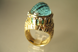 The finished ring with the faceted cabochon of Aquamarine mounted in the top of the ring