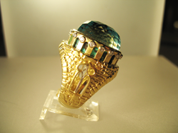 A side view of the finished ring where you can see the spiderweb Turquoise through openings on the side of the ring.