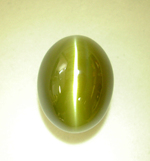 The Chrysoberyl cat's eye which has been repaired.