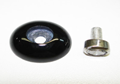 Photo of an oval black Onyx cabochon which has an oval diamond tube counter-sunk in the center of the cabochon.