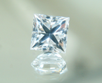 A square princess cut white synthetic sapphire.