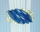 Ring inlaid with lapis that has 3 ribs carved into it.