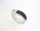 Small pic a ring with a carved black jade inlay.