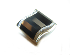 Photo of white gold cufflinks inlaid with faceted Black Onyx.