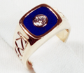Photo of a signet style ring with diamond in the middle of a Lapis inlay.