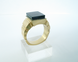 Photo of the ring with the Black Jade glued in the ring.