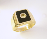 Photo of a ring with a round hole in the middle of the black Jade inlay.