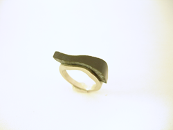 Photo shows the Black Jade inlay glued in place in the ring.