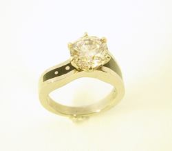 Photo shows the finished ring with the Diamond in place.