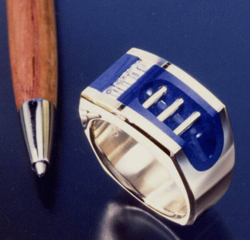 Ring with Lapis with a channel of baguette diamonds which are held in place by bezels of Lapis.