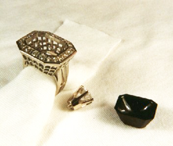 Ring with the finished black jade carving sitting next to it and also the diamond which will be mounted into it.