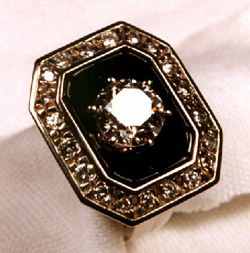 The carved black jade is set into the ring. The diamond is now set in the center.