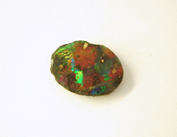 A Black Opal which is chipped on the sides.