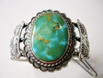 A Turquoise cabochon which is broken and needs to be repaired.