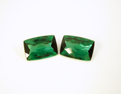 Photo of the finished matching set of green Tourmaline cushions.