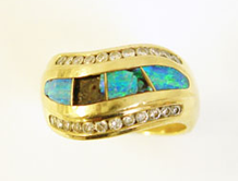A ring inalid with Opal inlays which are broken.