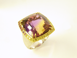 Photo of a ring with a large cushion Ametrine which needs the table re-polished.