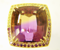 Shows the Ametrine after the table has been re-polished.