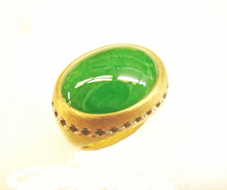 A ring with an intensely green Impaerial Jadeite cabochon which has been re-polished.