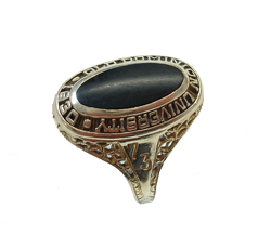 A ladies class ring with a black Onyx cabochon which is very scratched and dull.