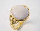 Ring with a Opal cabochon which needs to be re-polished.