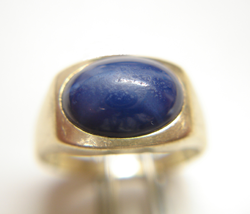 Picture of a Linde Star Sapphire which is in a ring and needs to be repolished.