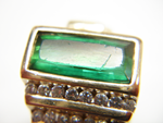 Picture of a green Tourmaline with a scratched table which needs the table repolished.